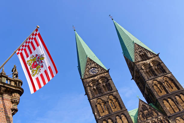 Bremen, Germany - St. Petri cathedral and the Bremen state flag flying from the historic city hall stock photo