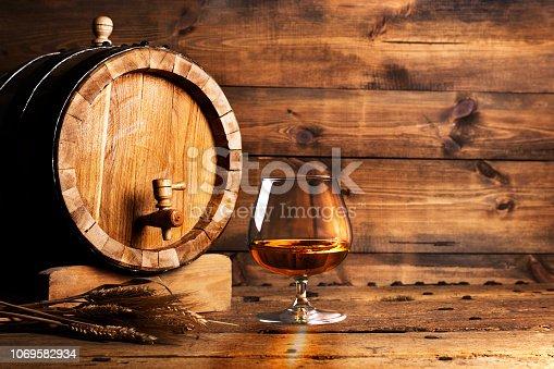Brendy glass and old oak barrel