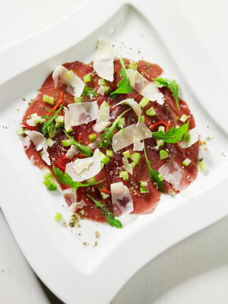 bresaola with parmesan spring onion and rucola - bresaola foto e immagini stock