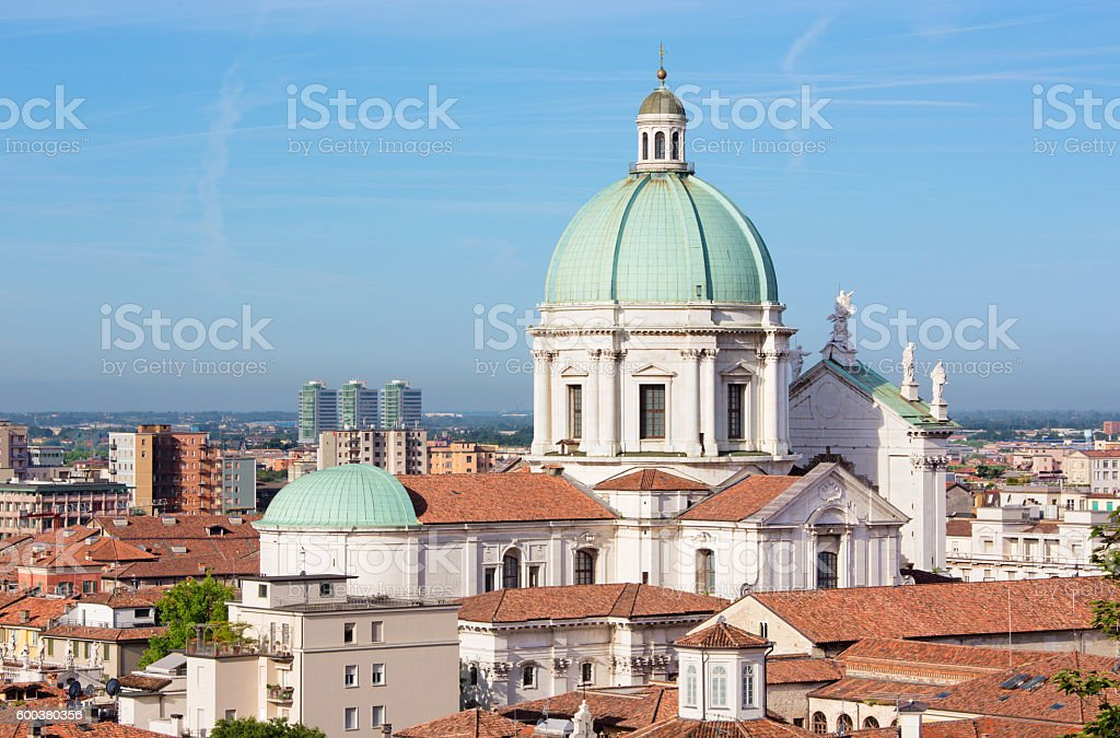 Brescia - The Duomo cupola over the town in morning - foto stock