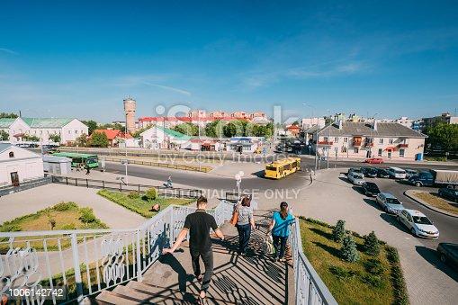 istock Brest, Belarus. People Rush On Pedestrian Crossing Bridge To Bus 1006142742