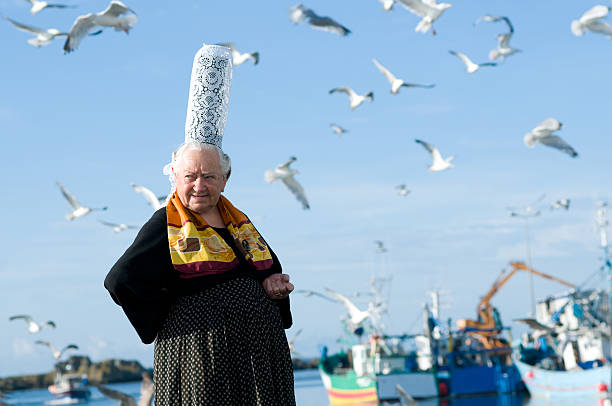 breton women with headdress breton women with headdress in brittany posing on a harbor bonnet stock pictures, royalty-free photos & images