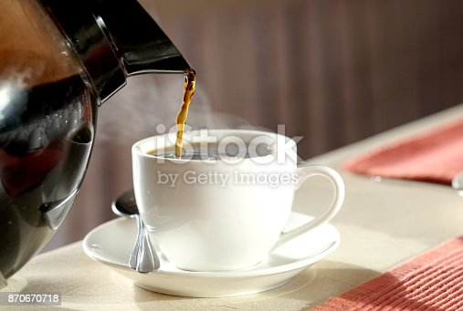 Brew hot coffee, pour hot coffee in a glass of smoke.
