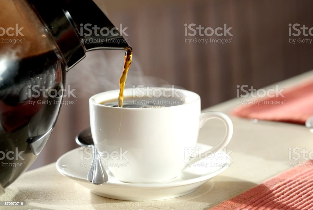 Brew hot coffee, pour hot coffee in a glass of smoke. stock photo