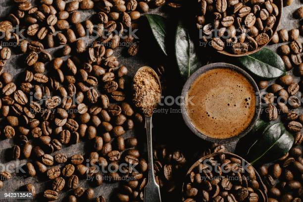 Photo of Brewed black coffee and beans in arrangement