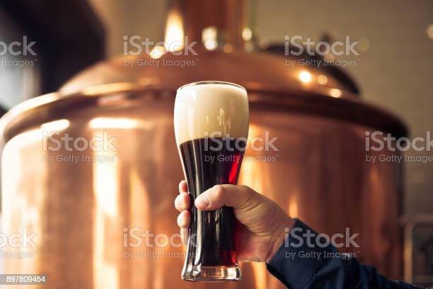 Brewer Holding Glass Of Bitter Ale Beer At Brewery Stock Photo - Download Image Now