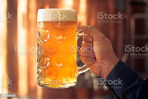 Brewer Holding Mug Of Beer In Front Of Copper Vat Stock Photo - Download Image Now