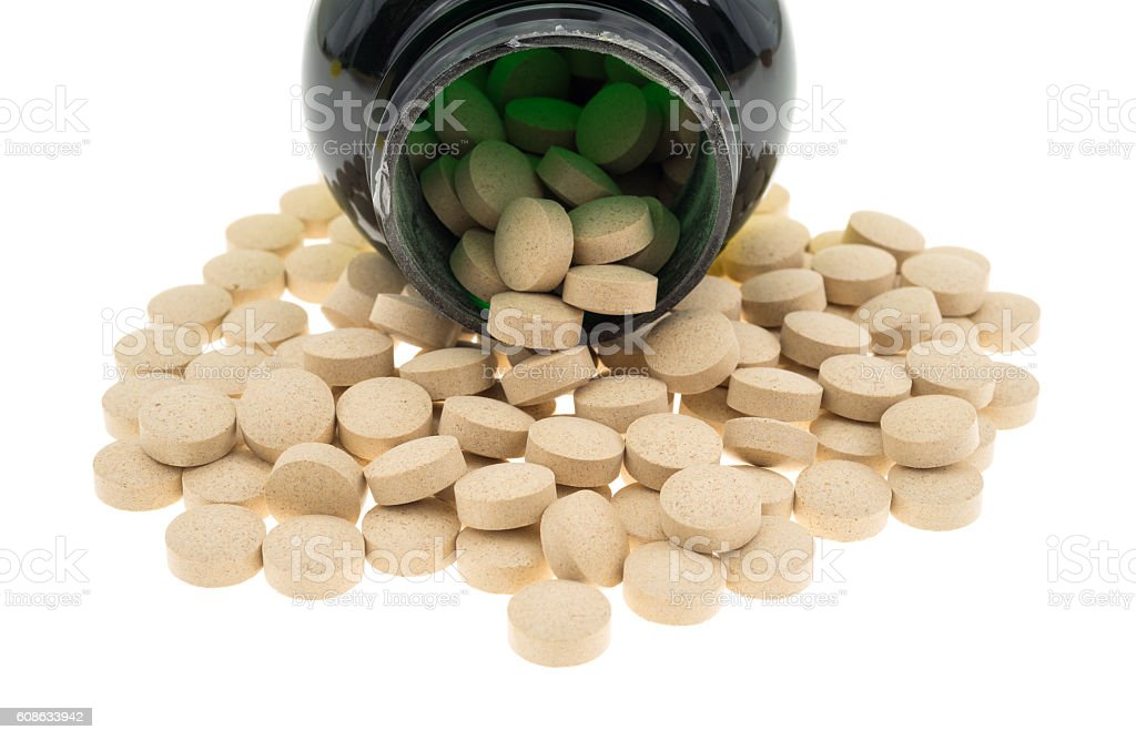 Brewer'€™s yeast nutritional supplement spilling from bottle stock photo