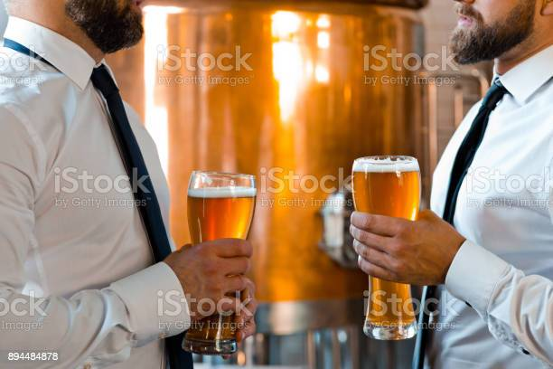 Brewery Business Partners Talking Over Beer Stock Photo - Download Image Now