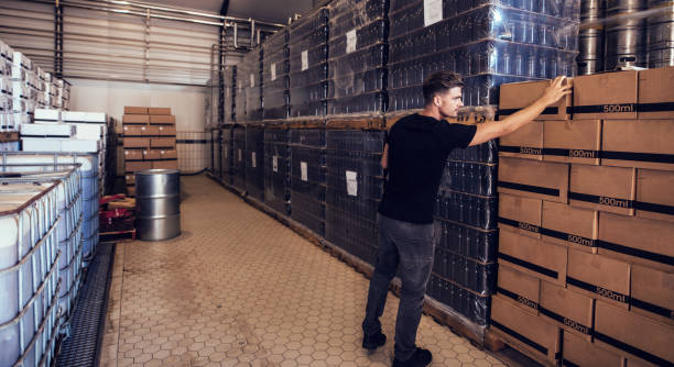 Brewery owner verifying the beer boxes in delivery storage area stock photo