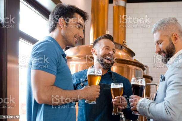 Brewery Team Having Beer After Work Stock Photo - Download Image Now