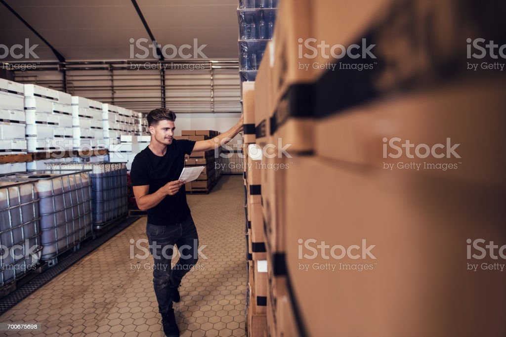 Brewery warehouse manager taking inventory stock photo