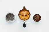 Brewing coffee in a coffee maker top view on a white background. Element separately in working form.