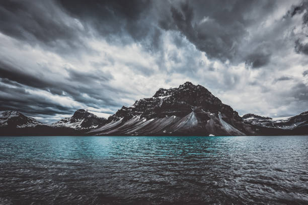 Brewing storm at Bow Lake in Alberta Canada stock photo