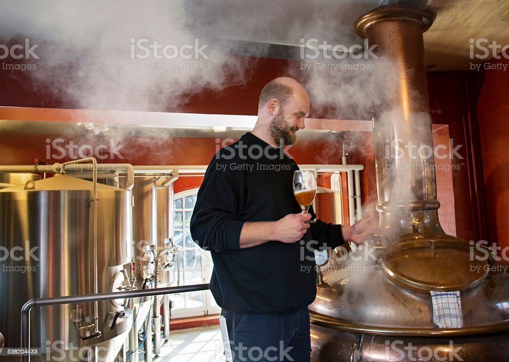 Brewmaster Checking His Brew stock photo