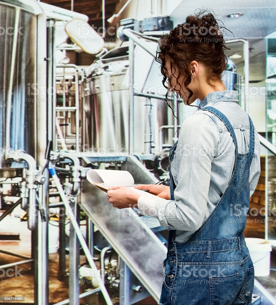Brewmaster working with clipboard in brewery stock photo