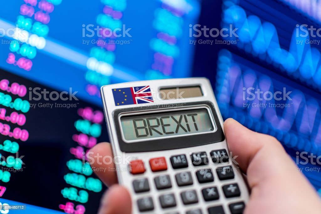 Brexit calculator with stock market screen stock photo