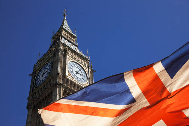 brexit concept - double exposure of flag and Westminster Palace with Big Ben stock photo