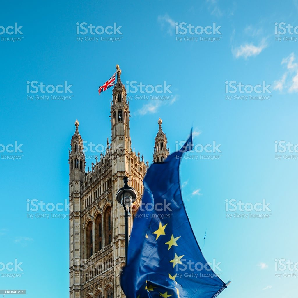 Brexit concept with European union flag juxtapositioned against Victoria tower, Westminster, London, UK stock photo