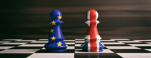 Brexit concept.United Kingdom and European Union flags on chess pawns on a chessboard. 3d illustration stock photo