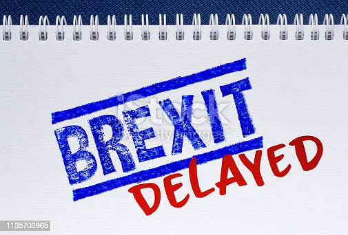 notepad with text brexit delayed