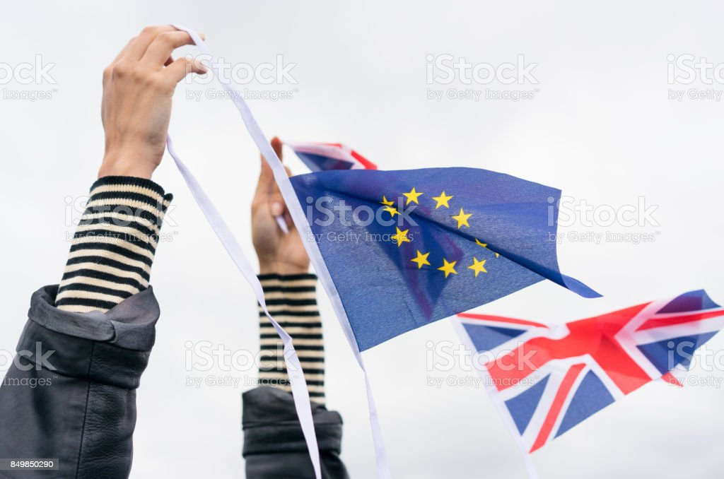 Brexit - Holding EU and UK Flags stock photo