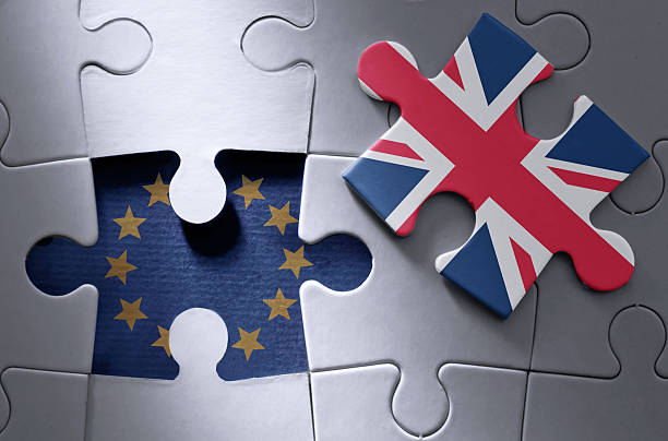 Brexit jigsaw puzzle concept stock photo