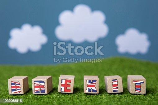 Britain leaving European Union. Word Brexit written on wooden blocks.