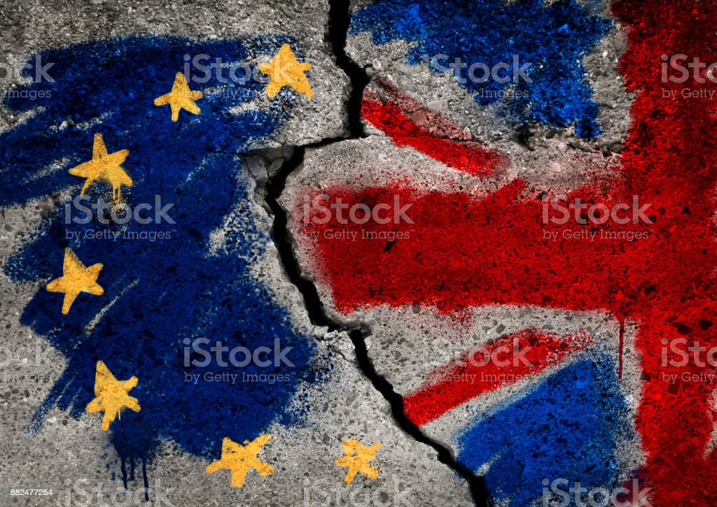 Brexit symbol. Concept illustration.  EU and UK flag on broken wall. stock photo