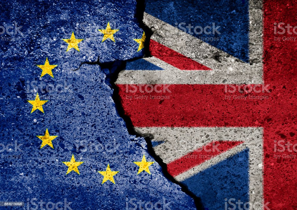 Brexit symbol. Concept illustration.  EU and UK flag on broken wall. stock photo