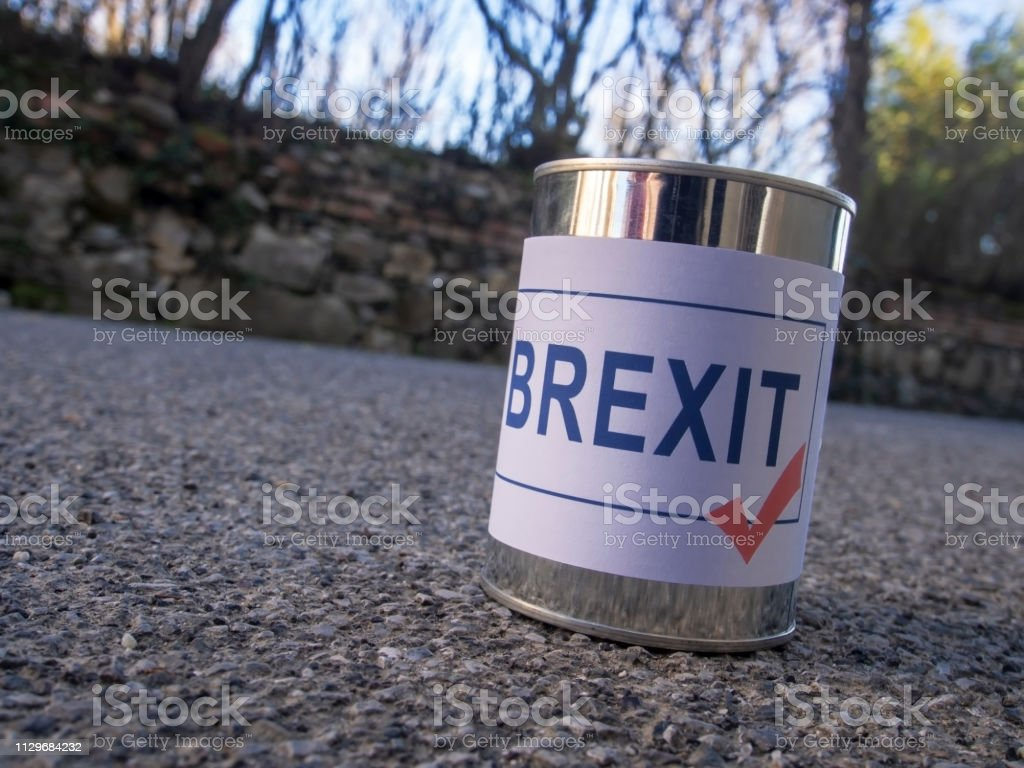 Brexit tin can in the road ready for a kick, UK EU politics metaphor.