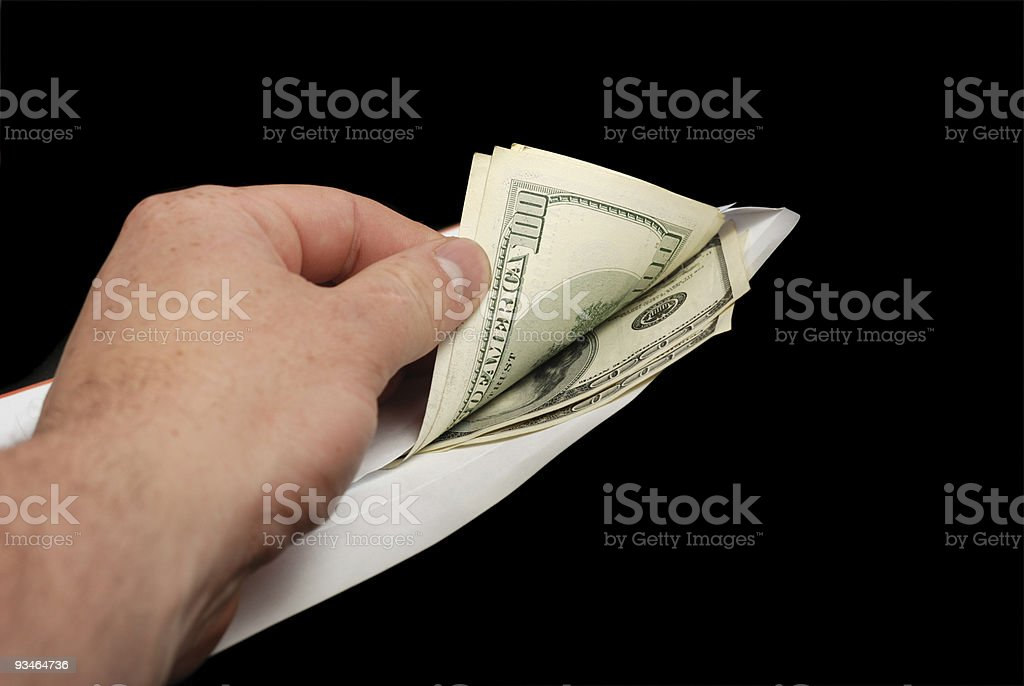 Bribe in an envelope and hand royalty-free stock photo