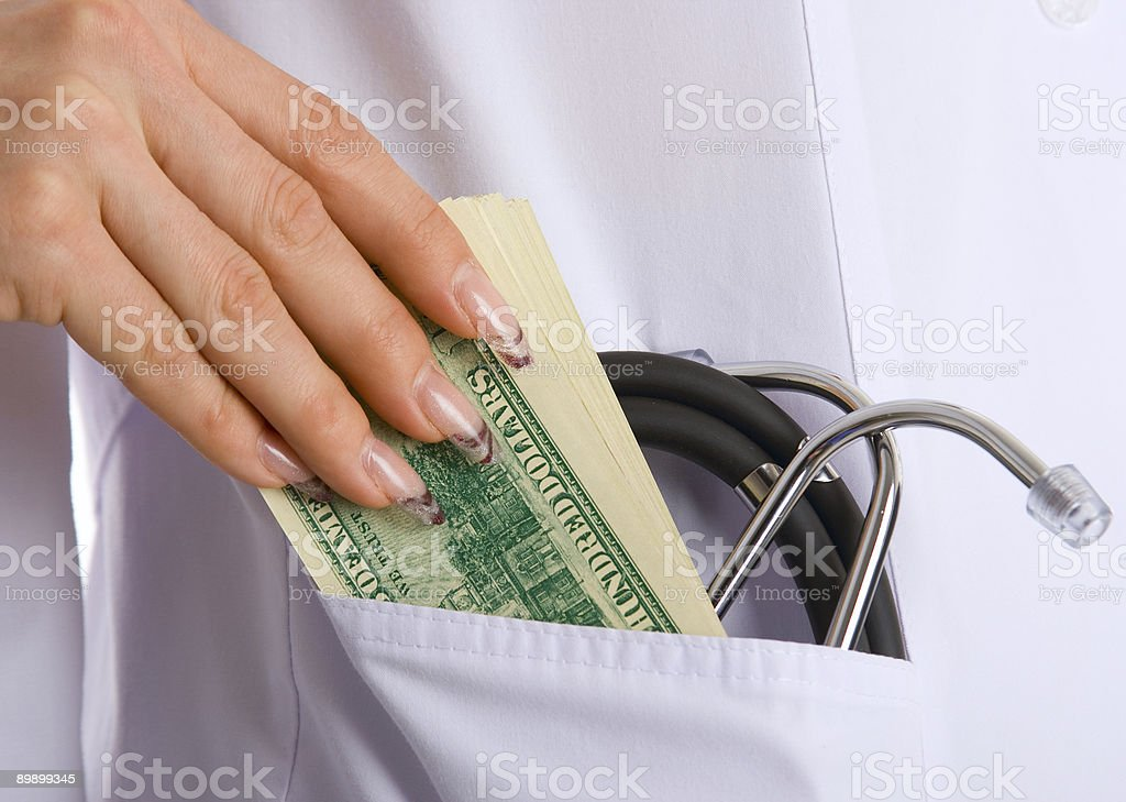 bribe to doctor royalty free stockfoto