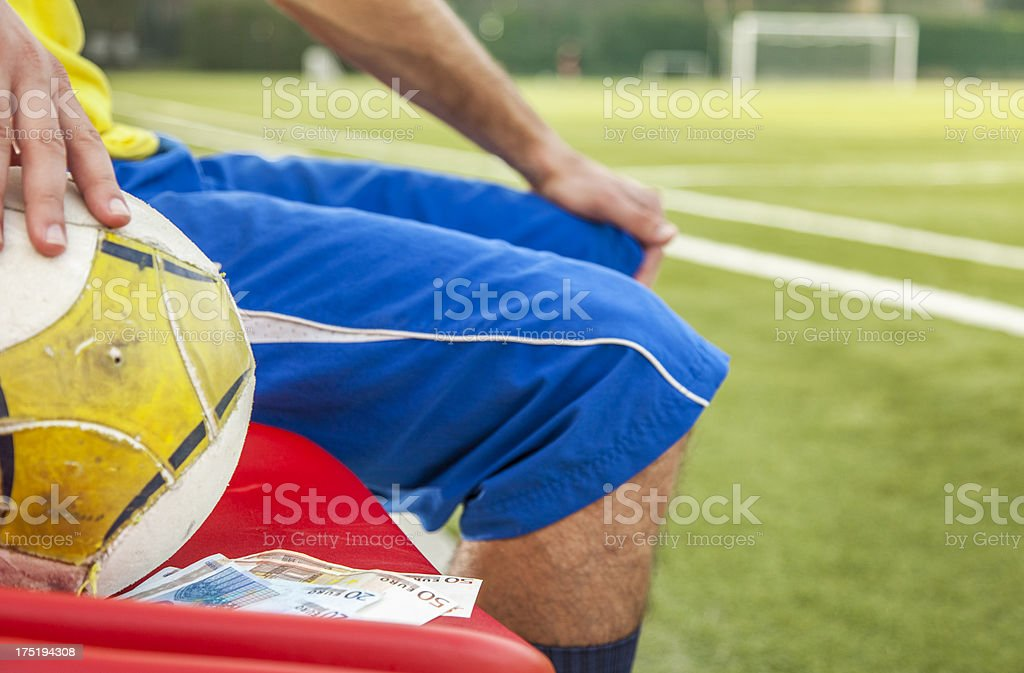 Bribed soccer player royalty-free stock photo