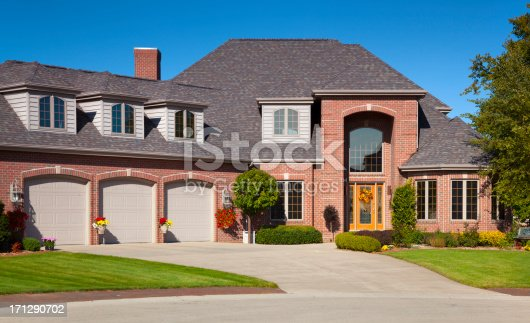 istock Brick and Cedar Home With Three Stall Garage 171290702