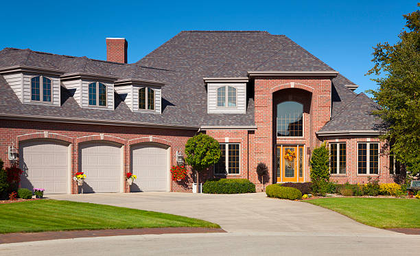 Brick and Cedar Home With Three Stall Garage stock photo