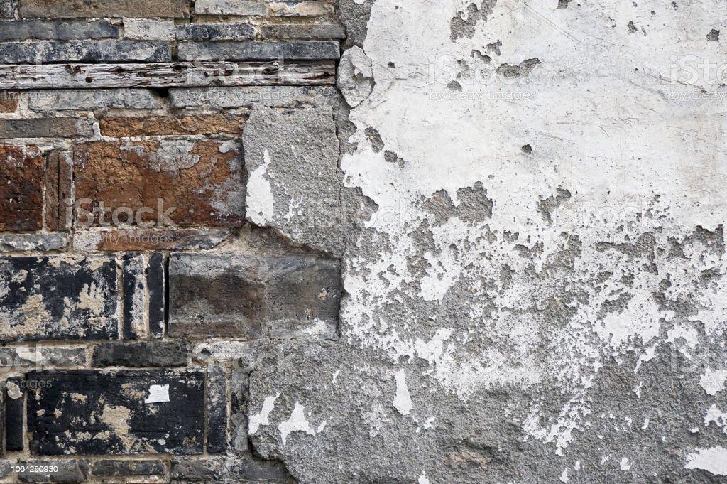 Brick and plaster background. stock photo