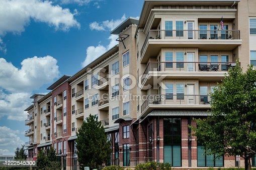istock Brick and Plaster Condos with Balconies 1222545300