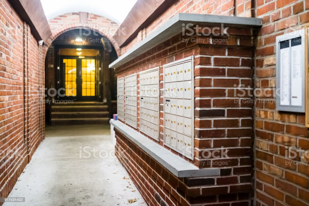 brick apartment building entrance in downtown nyc new york city with