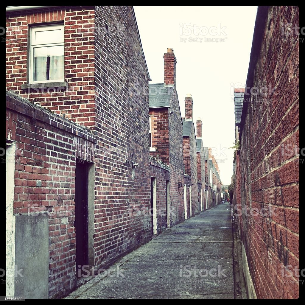Brick Back Alley Streets in Belfast Northern Ireland royalty-free stock photo