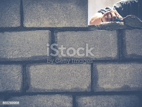 istock Brick Builders Are Building Walls 855269958