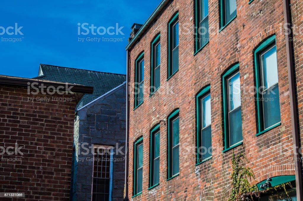 Brick Buildings Against the Sky stock photo