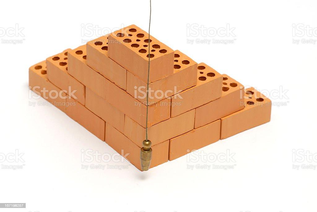 Brick corner with  plumb line stock photo