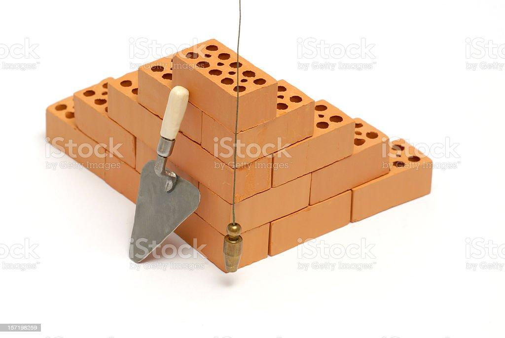Brick corner with trowel and plumb line stock photo