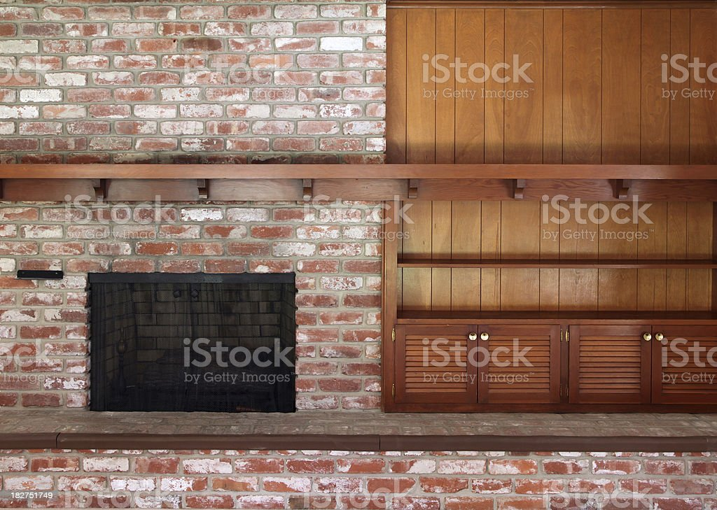 Brick Fireplace with Wood Shelf stock photo
