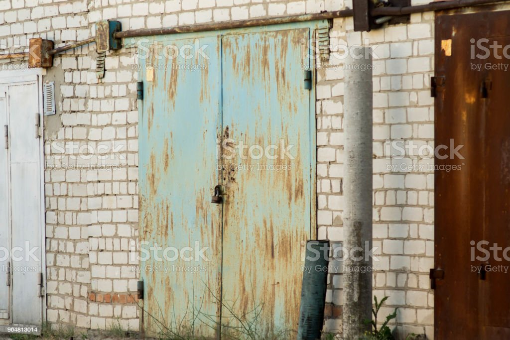 Brick garages with metal gates of a garage cooperative royalty-free stock photo