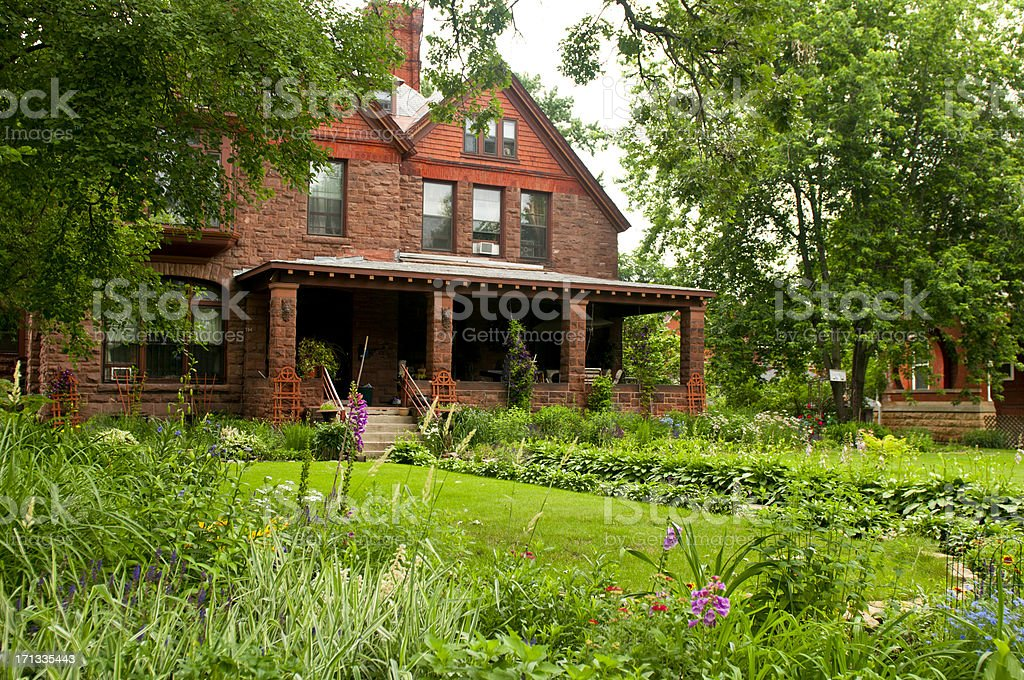 Brick Home and Landscaped yard stock photo