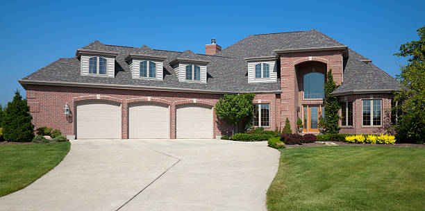 Brick Home With Three Stall Garage stock photo