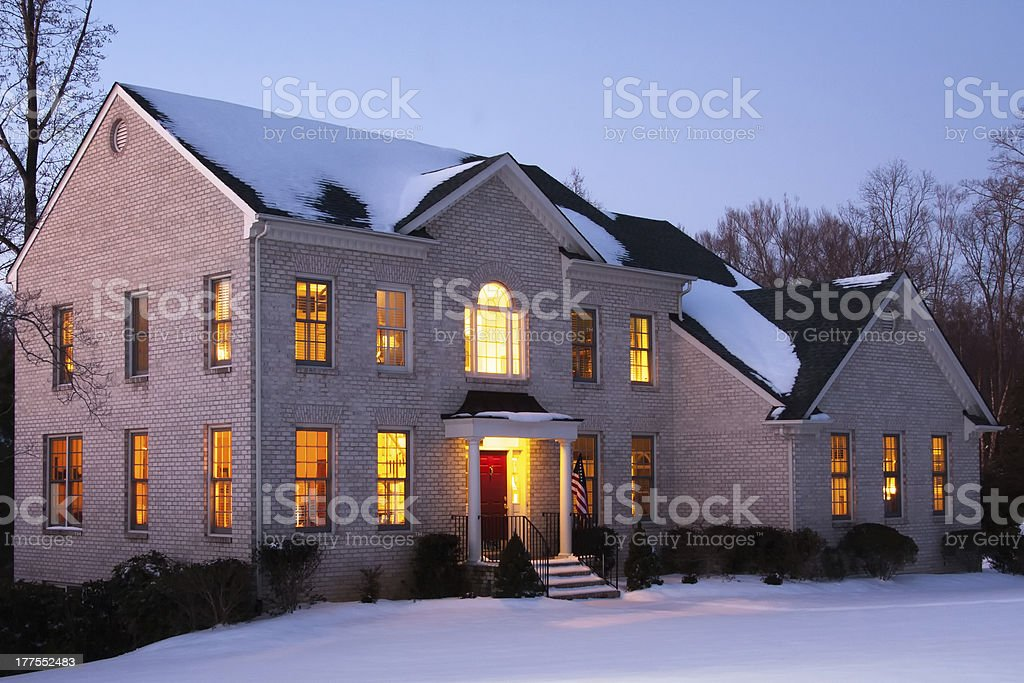 Brick House at Dusk with Snow stock photo