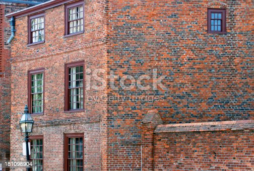 Old house with spalling bricks from the 18th century in Boston MA
